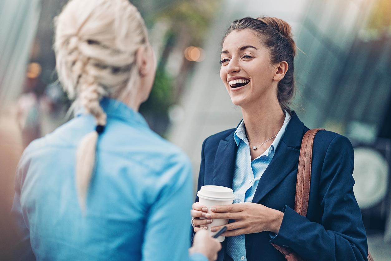 Businesswomen talking outside the office building
